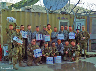 Soldiers holding FSO care packages